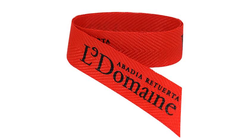 Cintas personalizadas. Personalización de cintas con serigrafía y sublimación que se aplican en cintas y cordones
