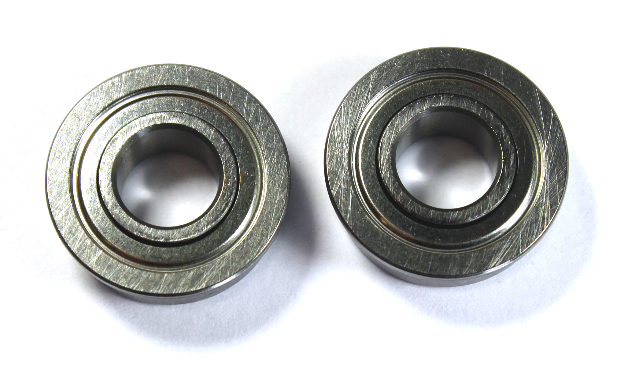 Taper O.D. bearings have a flange on the outer ring, an extended or wider inner ring and an outer ring that is slightly