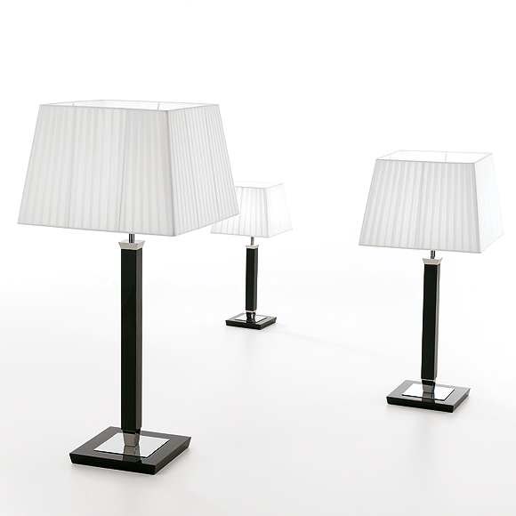 The slender shape of the base, the black laquered wood body and the beautiful pleated short square shade epitomize the a