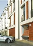 La porte de garages collectifs ET500 Hörmann a sans doute le fonctionnement le plus silencieux du marché. Dotée d'un sys