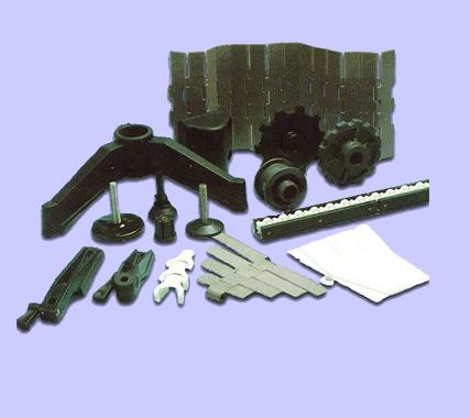 Kardankedjor, bandkedjor och flexbandkedjor i en mängd olika material och bredder. Drivhjul, returhjul och returrullar t