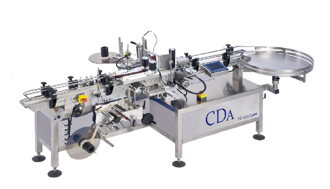 Conçue par la société CDA, la Ninon Down est une étiqueteuse automatique permettant l'étiquetage des produits cylindriqu