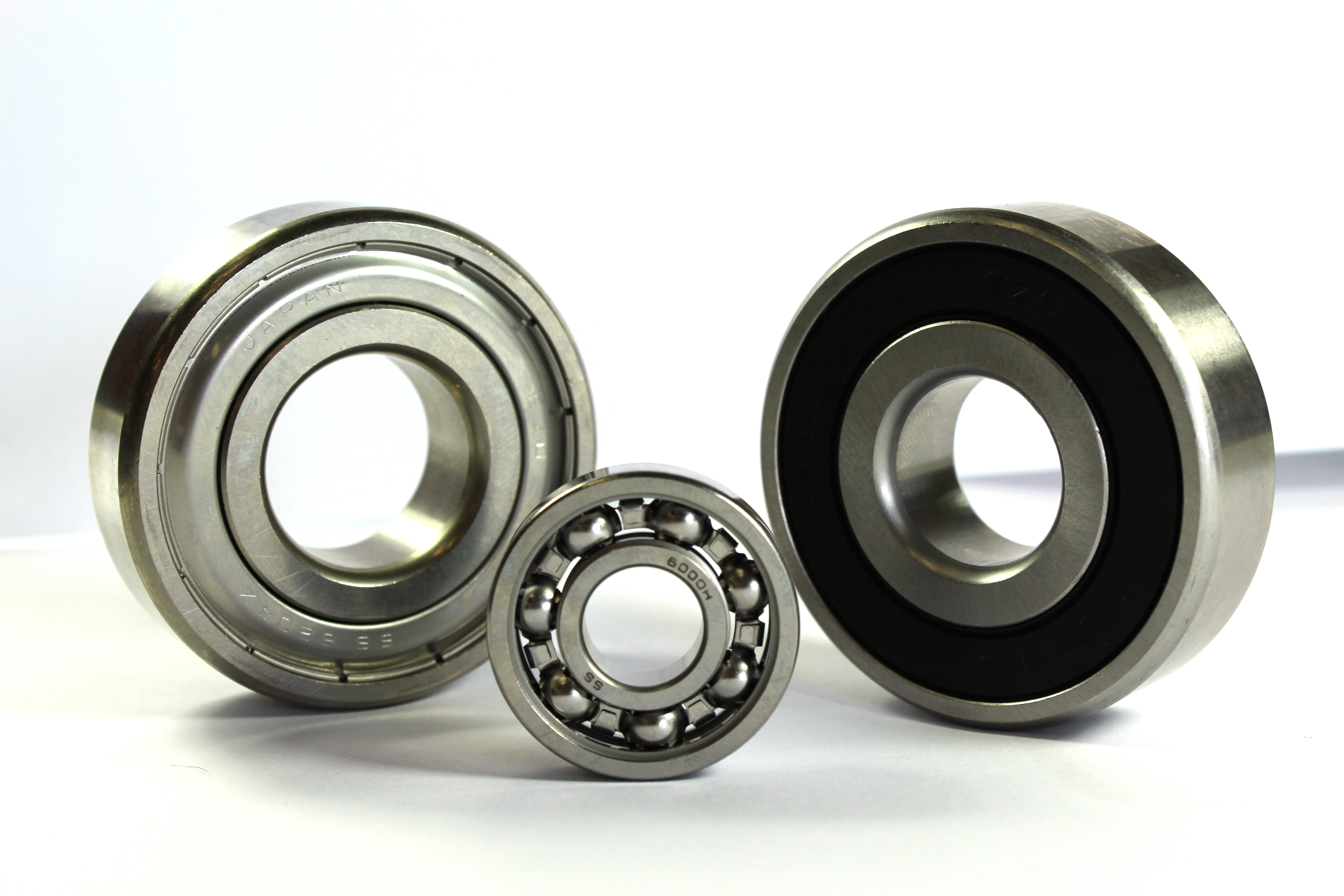 Stainless steel miniature bearings with extended inner ring have an inner ring that is wider than the outer ring by 0.03
