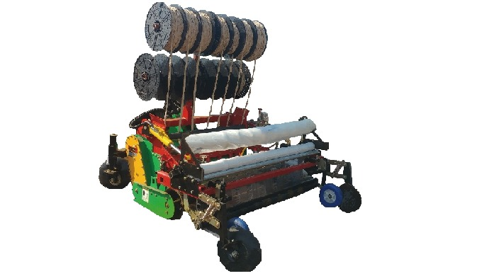 Garlic Planter | garlic seeder, seed planter The planter buries the string of garlic seeds  under the ground · The garli