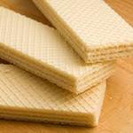 Fabrication de biscuits, chocolat, et gaufrettes Le plus souvent fourrée avec duchocolat, de la praline ou de la crème