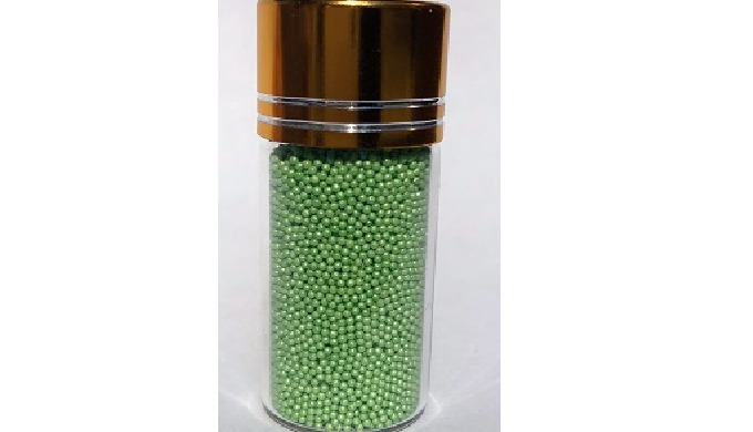 Ferrous fumarate microcapsules, pellets, spheres, beads