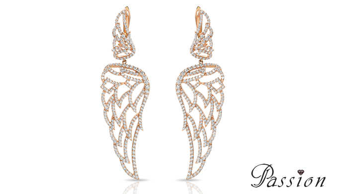 Boucles d'oreilles en or rose serties diamants