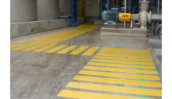 Any walkway or ramp in an industrial setting, whether an offshore platform, onshore refinery, manufacturing plant, stora
