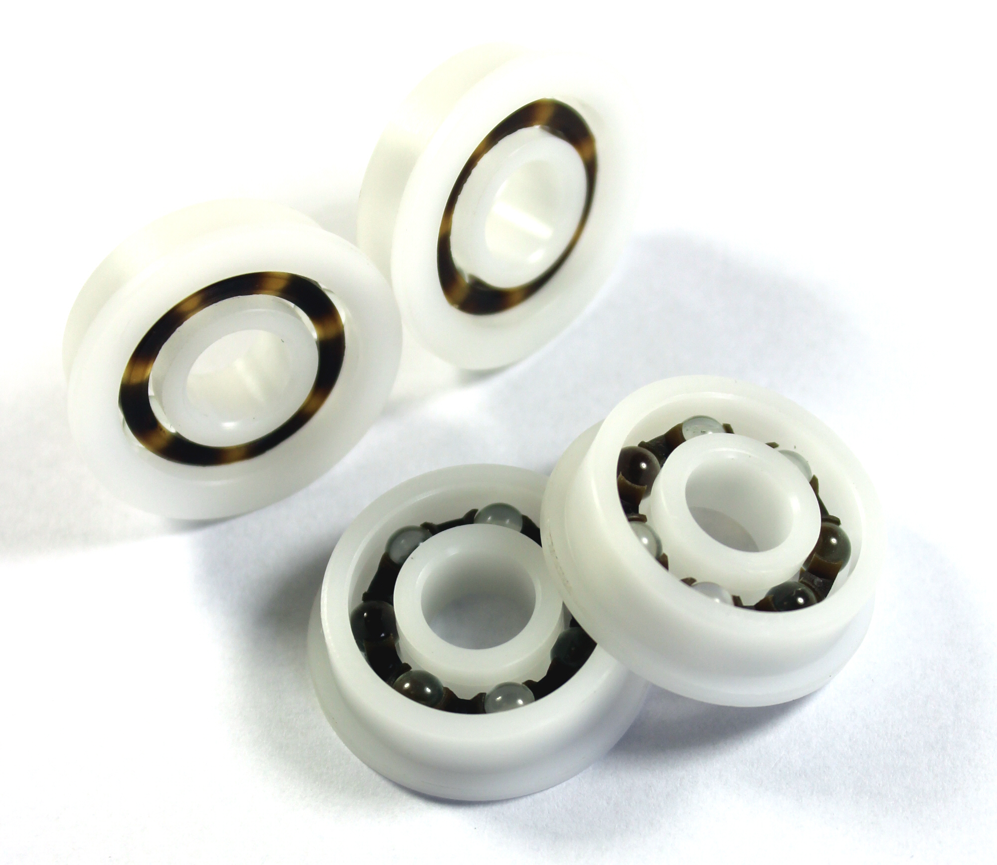 Plastic ball bearings are most commonly stocked with acetal resin (POM) rings and nylon (PA66) cages. The balls are norm